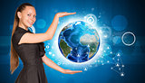 Beautiful businesswoman holding Earth