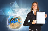 Beautiful businesswoman holding paper holder. Earth, triangles and graphs