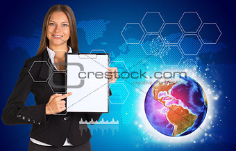 Beautiful businesswoman in suit holding paper holder. World map, Earth and hexagons