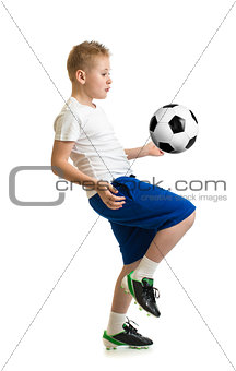 Boy kicking soccer ball by knee isolated on white. Training exer