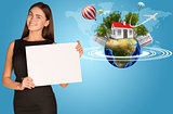 Beautiful businesswoman holding paper holder. Earth with buildings and trees