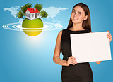 Beautiful businesswoman holding paper holder. Earth with house and trees