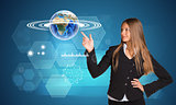 Beautiful businesswoman finger presses Earth. Hexagons and graphs