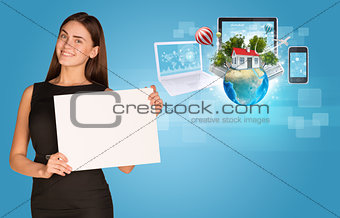 Beautiful businesswoman holding paper holder. Electronics, Earth with buildings and trees