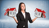 Businesswoman holding housees in hands