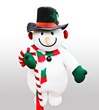 Cute snowman doll captured in close up over white background