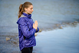 Young Beautiful Woman Meditate on the River