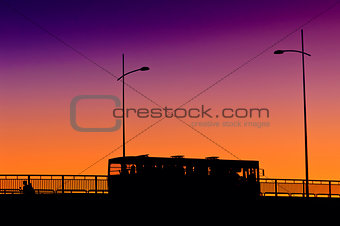 City bus in sunset