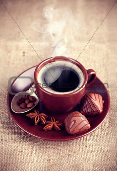 Cup hot coffee with chocolate sweets