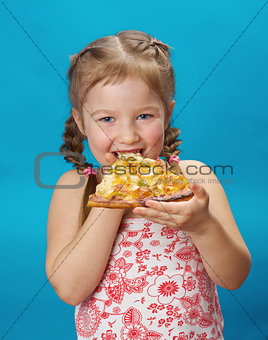 little girl eating pizza