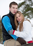 Gentle embrace of a young couple in love outside in winter
