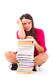 Portrait of a girl teenager with her books on white