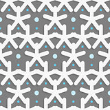 White shapes with blue dots on dark gray pattern