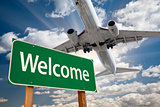 Welcome Green Road Sign and Airplane Above