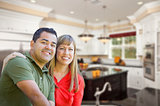 Mixed Race Couple Inside Beautiful Custom Kitchen