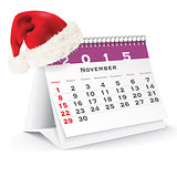 November 2015 desk calendar with Christmas hat