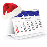 December 2015 desk calendar with Christmas hat