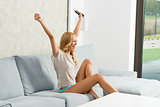 girl exulting on sofa