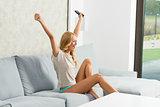 girl exulting on sofa