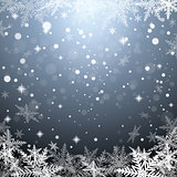 Christmas snowflakes on gray background.