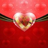 Golden rings in glass heart