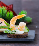 appetizer canape with fresh cucumber, arugula and shrimp