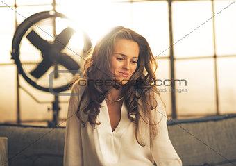 Portrait of elegant young woman in loft apartment