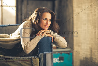 Portrait of thoughtful young woman in loft apartment