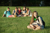 Cute Teen Sitting Near Group