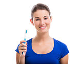 Beautiful woman with a toothbrush