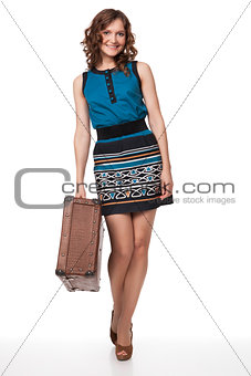 Portrait of happy young woman with suitcase