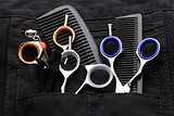 professional tools of hairdresser in black case