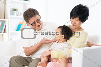 Asian family portrait at home