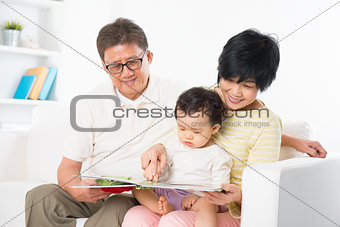 Asian family reading