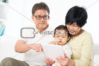 Asian family using tablet pc