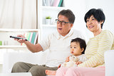 Asian family watching tv
