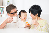 Asian family drinking milk