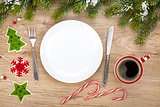 Empty plate, coffee cup and christmas decor