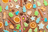 Christmas wooden background with candies, spices, gingerbread co