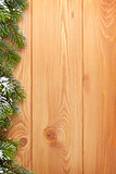 Wood texture with snow firtree christmas background