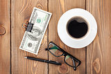 Money cash, glasses, pen and coffee cup