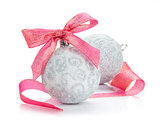 Christmas baubles and red ribbon