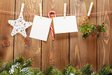 Snow fir tree, photo frame and christmas decor on rope