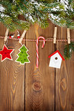 Snow fir tree and christmas decor on rope