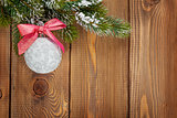 Christmas fir tree and bauble with red ribbon