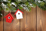 Christmas fir tree and birdhouse decor