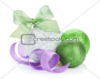 Christmas baubles and colorful ribbon