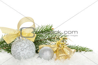 Christmas baubles and golden ribbon with snow fir tree