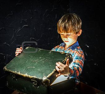 Little boy finding treasure