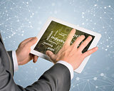 Man hands using tablet pc. Money and business words on touch screen